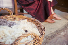 Skeins of wool in a basket ready to be spun by an ancient medieval. Royalty Free Stock Images