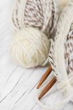 Skeins of wool and wooden knitting needles Royalty Free Stock Photography