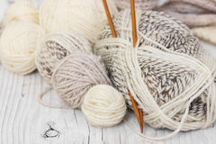 Skeins of wool yarn and knitting needles Stock Photography