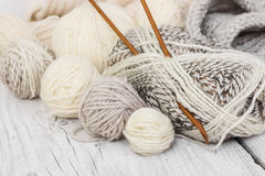 Skeins of wool yarn and knitting needles Royalty Free Stock Images