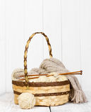 Skeins with woolen threads for knitting in a wicker basket Royalty Free Stock Images