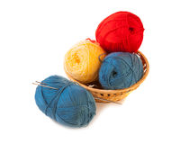 Skeins of yarn in a basket with knitting needles Stock Images
