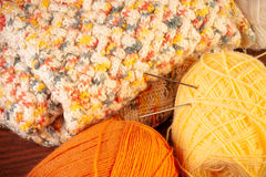 Skeins of yarn with knitting needles and knitted thing Royalty Free Stock Image