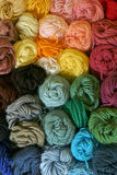 Skeins of Yarn - Vertical. Practical and colorful storage of skeins of yarn being used for different knitting, crocheting, and needle-point canvas projects stock image
