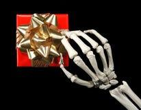 Skelet met gift royalty-vrije stock afbeelding