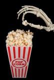 Skelet met popcorn stock foto's