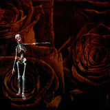 Skeletal figure and roses Stock Photography