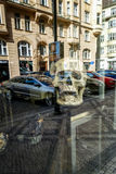 Skeletal head and a reflection of the street shop window. Royalty Free Stock Photo