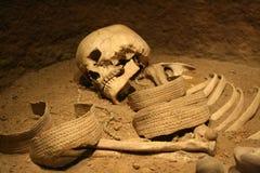 Skeleton. Prehistoric grave - photo of a skeleton in sand Stock Photo