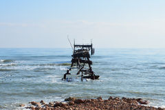 Skeleton of abandoned oil rig stock images