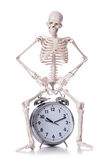 Skeleton with alarm clock Royalty Free Stock Photos