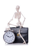Skeleton with alarm clock on the white Royalty Free Stock Images