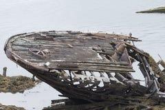 Skeleton of an ancient ship after crash Stock Images