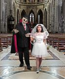 Skeleton as groom holds hand his bride Stock Photo