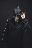 Skeleton in a black robe holds sunglasses Stock Images