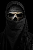Skeleton in black veil with dark environment Royalty Free Stock Photography
