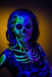 Skeleton bodyart with blacklight Stock Images