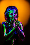 Skeleton bodyart with blacklight Royalty Free Stock Photography
