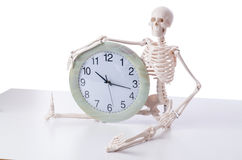The skeleton with clock isolated on white Stock Images