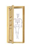 Skeleton in the closet. With a partially opened door - path included stock photos