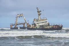 Skeleton coast Namibia. An abandoned boat in the skeleton coast in Namibia stock photos