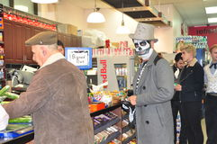 Skeleton in convenience store. Costumed skeleton buying snacks in convenience store during Zombie Crawl and Parade 2015 in Toronto, Ontario, Canada Royalty Free Stock Image