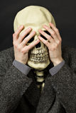 Skeleton covering his eyes Stock Images