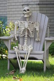 Skeleton  (Decorative) in Chair for Halloween Stock Images