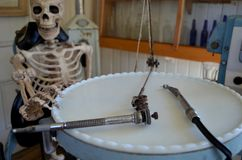 Skeleton in a dentists chair royalty free stock photos