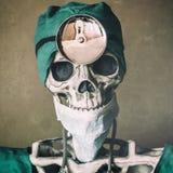 Skeleton Doctor Hear Mirror stock images