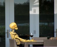 Skeleton drinking red wine Royalty Free Stock Photos