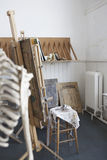 Skeleton And Easel In Artist's Studio Stock Photos