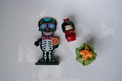 Skeleton figurine with flowers royalty free stock images
