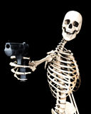 Skeleton And Gun 5. An image of a skeleton with a firearm, a possible interesting conceptual modern version of death. Or a medical image of a Skeleton in action Stock Image