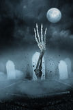 Skeleton hand bursting from the grave Stock Photos