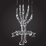 Skeleton hand with chalk on a blackboard, and a Stock Images