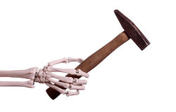 Skeleton hand with old hammer stock photos
