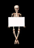 Skeleton holding empty blank over black Stock Image