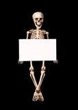 Skeleton holding empty blank over black Stock Image