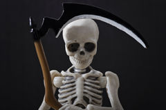 Skeleton holding scythe Royalty Free Stock Photography