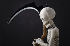 Skeleton holding scythe Stock Photo