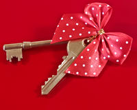house keys and bow. A closeup of house keys and a bow Stock Images