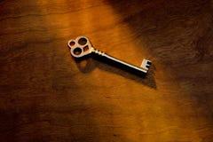 Skeleton key. An antique skeleton key on a sunlit background Stock Photography