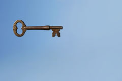 Skeleton Key on Blue Sky Background Stock Image