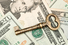 Skeleton key on cash. Royalty Free Stock Photos