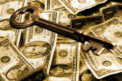 Skeleton Key And Money. US Currency and Skeleton key. Sepia toned overall with focus on key Stock Images