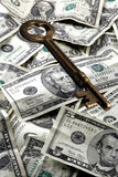 Skeleton Key And Money. Old brass skeleton key and US Cash. Portrayal of business, financial success Royalty Free Stock Photography
