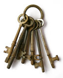 Skeleton Keys. A ring of vintage skeleton keys over white background stock images