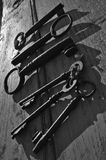 Skeleton keys on top of an old wooden surface Royalty Free Stock Images
