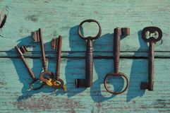 Skeleton keys on top of an old wooden surface Stock Images